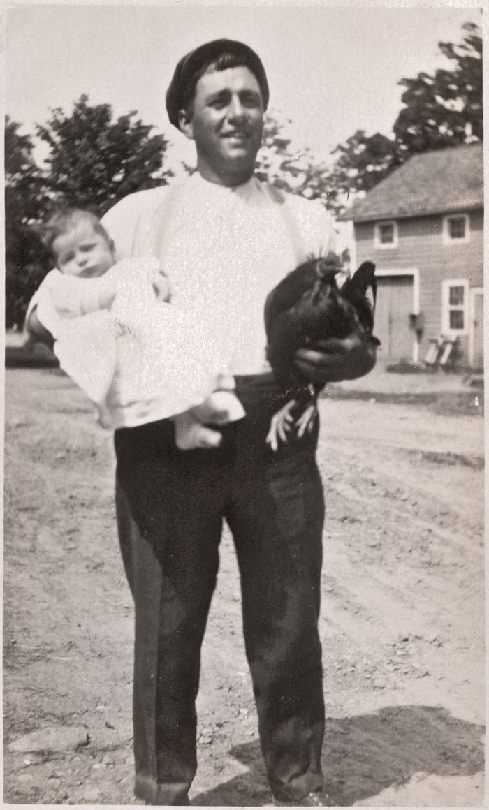 father with baby and rooster